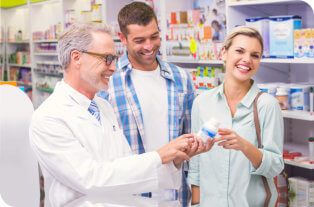 pharmacist and couple laughing